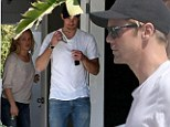 Another victim? Alexander Skarsgard sports a casual yet studly look as visits an art gallery with a mystery blonde woman