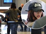 Just like any other flyer! Flame-haired Megan Fox gets a thorough TSA pat-down at LAX en route to shoot Ninja Turtles