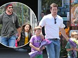 Fathers in action! Mark Wahlberg takes his sons on a flower-purchasing mission, whilst Hugh Jackman has a scooter adventure with his daughter Ava