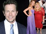 Perks of the job! Mark Wahlberg is flanked by his two glamorous co-stars Rebel Wilson and Bar Paly at Pain and Gain premiere