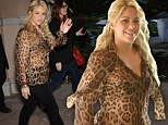 Wild thing! New mother Shakira shows off toned tummy in sheer shirt just weeks after giving birth to hit up NBC bash