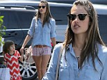 Following in mommy's footsteps! Alessandra Ambrosio's daughter proudly carries a shopping bag... as her model mother parades her pins in hotpants