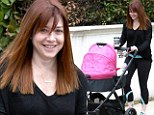 Fresh-faced and freshly trimmed? Alyson Hannigan takes her daughter Keeva for a stroll sporting her signature smile... and new bangs?