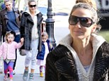A family affair! Sarah Jessica Parker pairs a fur coat with high top trainers as she takes the entire brood to school