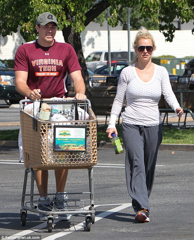Happy families: Britney and David looked like any other couple doing the routine grocery run