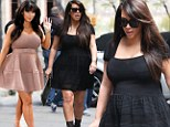 Better in black! Pregnant Kim Kardashian wears similar voluminous knit dress after suffering disaster in pink... as it's revealed 'her bra size has gone up to a size F'