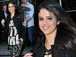 She's got a spring in her step! Selena Gomez beams as she steps out in Bieber-inspired baggy trousers following romantic rendezvous with Justin