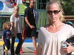 Coping with the accident: Kendra Wilkinson, her husband Hank Baskett and son Hank Baskett IV were seen at the children's parking in Calabasas, California following Sunday's car crash