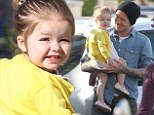 He's got a little comedian on his hands! David Beckham grins as he totes giggling daughter Harper