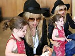 Long locks like mommy! Rachel Zoe ties her son Skyler's hair back into a ponytail as they enjoy a messy pottery painting session