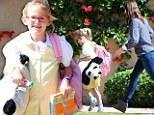 Precious panda! Jennifer Garner's daughter Violet latches onto a furry stuffed animal as she leaves class with her mother