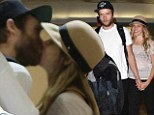 Love connection: Teresa Palmer and boyfriend Marx Webber cannot keep their hands off each other at the airport