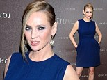 Uma Thurman poses prior to the Louis Vuitton Maison opening in Munich, Germany