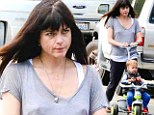 Single mother Selma Blair looks exhausted as she takes little son Arthur to the park