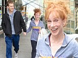 Dishevelled Kathy Griffin makes a quick dash to hide her bare face after running into photographers waiting for Kim Kardashian