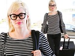 Rose McGowan makes her way through Los Angeles International Airport to catch a departing flight