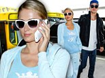 Love-birds in flight! Paris Hilton and her boyfriend River arrive at LAX to jet off to Colombia to promote Paris' own line of handbags