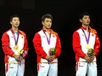Gold medallists Ma Long, Wang Hao and Zhang Jike pose on the podium
