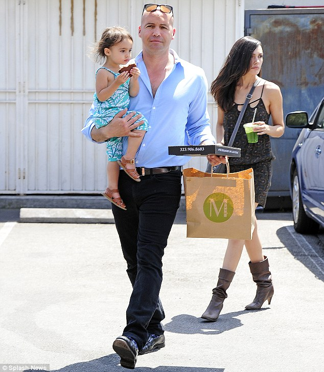 Food run: Billy Zane clutches his two-year-old daughter as he and girlfriend Candice Neil grabbed lunch to go on Monday in West Hollywood