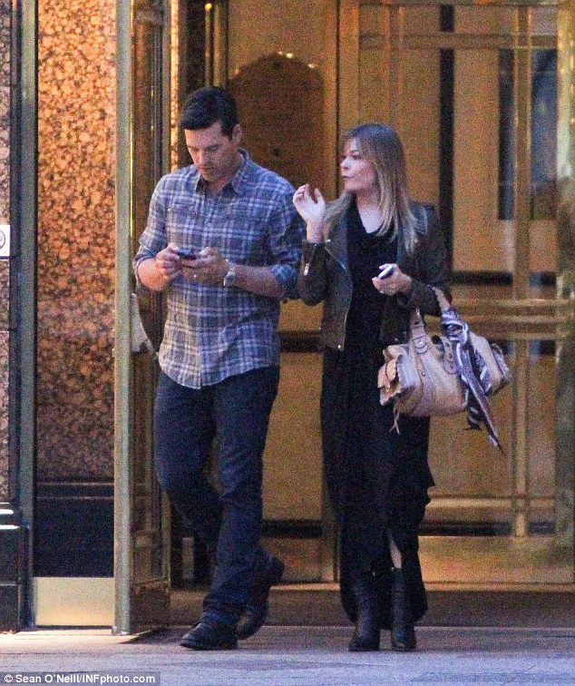 Taking care of business: Eddie checked his phone while LeAnn made conversation as they headed out to dinner