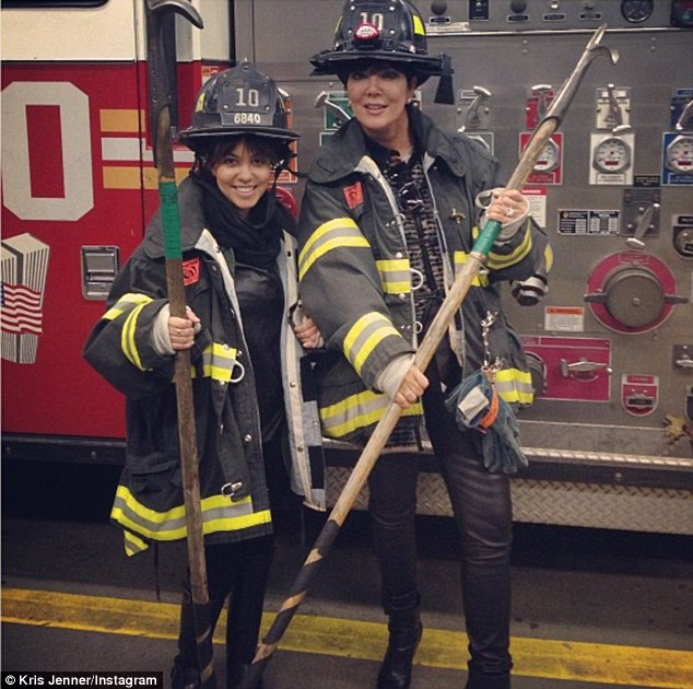 Where's the hose? Kris Jenner and her daughter Kourtney Kardashian donned firefighter gear and brandished pike poles for an Instagram picture in New York Tuesday