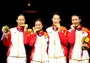 China celebrate Gold in the women's Epee Team Fencing finals
