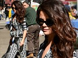 Selena Gomez looks mature beyond her years in midriff-bearing top and matching trousers during an appearance on Good Morning America