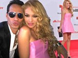 Paulina Rubio shows off her flawless legs in a pink mini dress as she cosies up to Marc Anthony at the Billboard Latin Awards