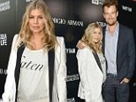 Maternity chic! Pregnant Fergie dresses her blossoming baby bump in monochrome blazer for night out with husband Josh Duhamel
