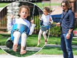 Swinging good time! Gabriel Aubry plays doting father at the park with his little girl Nahla