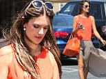 Gone with the wind! Alessandra Ambrosio accidentally shows off her perfect pins as her split maxi skirt blows up in the breeze