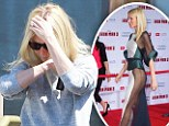 Paltrow, 40, emerged make-up free from a Santa Monica, California, studio on Thursday - and was apparently not as keen to show off.