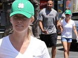 Recovering nicely: Kendra Wilkinson showed off her legs in mini-shorts on Thursday with husband Hank Baskett as she looked fully recovered from her recent nasty car accident