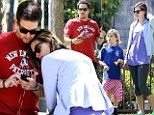 He's a family man! Mark Wahlberg shows his soft side as he snuggles with his wife while daughters attend birthday bash in the park