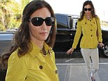 Baby's in... Yellow: Paul McCartney's wife Nancy Shevell embraces spring fashion in colourful ensemble as she jets out of LA