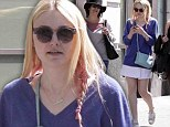 Raiding mum's closet! Dakota Fanning mimics her tennis pro mother in sporty skirt as she enjoys sunny city stroll with friends