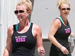 Britney Spears rocking a tank top that reads, 'Do You Wanna Kiss' as she leaves a gym in Santa Monica