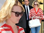 Earning her stripes! January Jones stands out in a bold red and white top and quirky oxford shoes as she gets in some retail therapy at Chanel