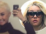 'This is the new me!' Amanda Bynes trades in the tangled extensions for undercut after shaving half her head