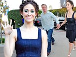 Shamelessly in love: Emmy Rossum and her co-star boyfriend Tyler Jacob Moore hold hands at friend's book launch