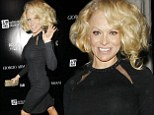 Pamela Anderson with mad hair at a charity event in LA