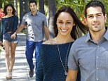 The thigh's the limit! Jesse Metcalfe's fiancee Cara Santana parades her toned pins in tiny Daisy Dukes during romantic outing with actor