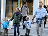 The chain! Naomi Watts and Liev Schreiber hold hands with their kids after dinner in LA