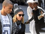 Here comes the Madon-terouge: Madonna and brood go to Kabalah in NYC on saturday morning