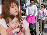 Forget the pacifier? Alyson Hannigan lets baby girl Keeva chew on her sunglasses during family shopping trip