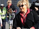 To be a kid again! Hugh Jackman's wife Deborra-Lee Furness scoots their daughter Ava to school on two-wheelers