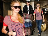 Put a bow on it! Paris Hilton trades her usual glam for casual jeans and girlish T-shirt at airport