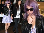 Family troubles aside: Kelly Osbourne puts on brave front as she jets to Sydney with fiance Matthew Mosshart