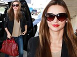 High-flying style! Miranda Kerr is effortlessly chic in leather-sleeved blazer and skinny jeans as she arrives at LAX