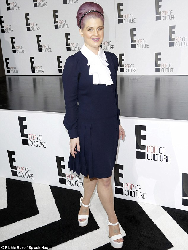 Twist on a trend: Her bonnet was slicked up into a bouffant style and she wore white open toe heels with the attire